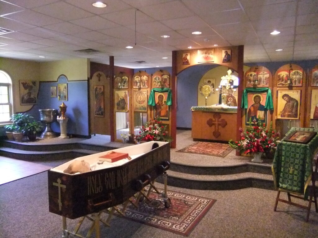 The body of Archpriest Peter E. Gillquist lying in state at All Saints' Orthodox Church, Bloomington, Indiana, the day before his burial. By User:Vmenkov - Own work, CC BY-SA 3.0, https://commons.wikimedia.org/w/index.php?curid=20159659